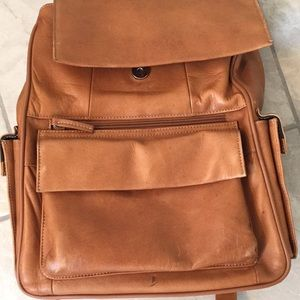 Brown leather backpack .